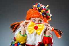 The clown in funny concept on dark background. Clown in funny concept on dark background Royalty Free Stock Photo
