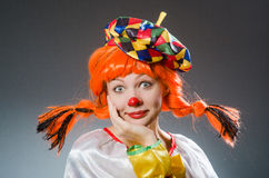 The clown in funny concept on dark background Royalty Free Stock Photography