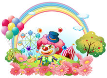 A clown in the garden with a carnival at the back. Illustration of a clown in the garden with a carnival at the back on a white background Stock Image