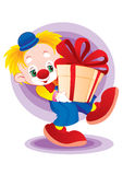 The clown with a gift Stock Image