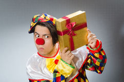 Clown with giftbox in funny concept Royalty Free Stock Photography