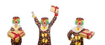 The clown with giftbox isolated on white. Clown with giftbox isolated on white royalty free stock photography