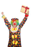 Clown with giftbox isolated on white Stock Photos