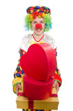 Clown with giftbox isolated on white Royalty Free Stock Photos