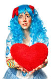Clown girl holding heart Royalty Free Stock Photography