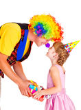 Clown giving present Stock Images