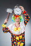Clown with hammer and clock Stock Photo