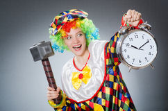 Clown with hammer and clock Stock Images