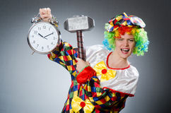 The clown with hammer and clock Royalty Free Stock Images