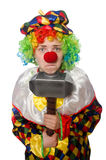 Clown with hammer isolated on white Royalty Free Stock Photography