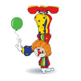Clown handstand. Vector illustration of cute cartoon redhead clown standing on his hand.  on a white background Royalty Free Stock Image