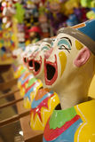 Clown Heads. A row of clown heads at a carnival Royalty Free Stock Photography