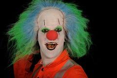 Clown heureux avec la perruque verte Photo stock