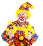 Clown heureux avec le chienchien de ballon Photographie stock libre de droits
