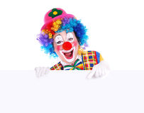 Clown heureux avec le panneau blanc Photo stock