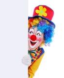 Clown heureux avec le panneau blanc Photographie stock