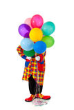 A Clown holding ballons Stock Photos