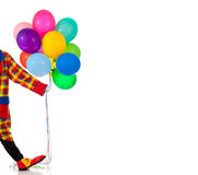 A Clown holding ballons Stock Images