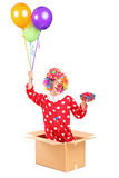 Clown holding balloons and a gift Stock Image