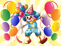A clown holding balloons Royalty Free Stock Images