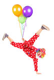 Clown holding balloons and standing on one hand Stock Photos