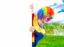 Clown holding a blank sign Stock Images