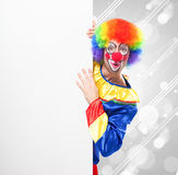Clown holding a blank sign Royalty Free Stock Photo