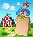 Clown holding board near tent Stock Photos