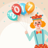 Clown holding bunch of colorful balloons Stock Photos