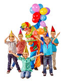 Clown holding cake and balloons on birthday with Stock Photos
