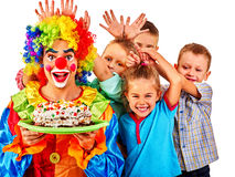 Clown holding cake on birthday with group children Royalty Free Stock Photo