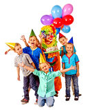 Clown holding cake on birthday with group children Royalty Free Stock Images
