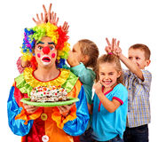Clown holding cake on birthday with group children Stock Images