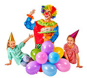 Clown holding cake on birthday with group children Royalty Free Stock Photos