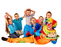 Clown holding cake on birthday with group happy Royalty Free Stock Photos