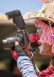 When A Clown Holding A Camera - Humor, no pun intended. A street shot of a clown entertaining kids at Songkran Water Festival, Thailand Stock Photography