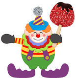 Clown holding candied apple Royalty Free Stock Images