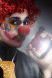 Clown Holding Flask Stock Photo