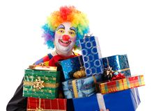 Clown with presents Stock Images