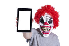 Clown holding a PC tablet Stock Photography