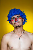 Clown In A Blue Wig Royalty Free Stock Photos