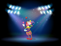A clown juggling balls in the stage Stock Photos