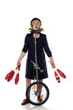 Clown with juggling clubs and a unicycle Royalty Free Stock Images