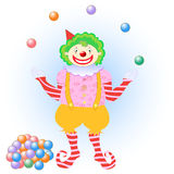 Clown juggling colorful balls Stock Photography
