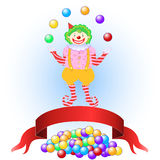 Clown Juggling Colorful Balls Stock Image