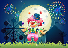 A clown juggling in front of the carnival. Illustration of a clown juggling in front of the carnival Royalty Free Stock Photos