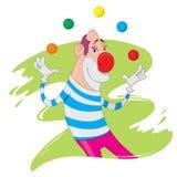 Clown juggling. A happy clown juggles balls Royalty Free Stock Image