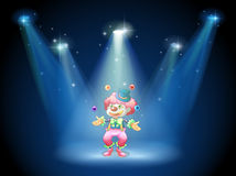 A clown juggling at the stage Royalty Free Stock Image