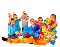Clown keeps cake on birthday with group children. Stock Images