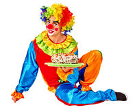 Clown keeps cake on birthday . Royalty Free Stock Photography